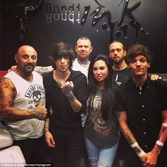 New ink: One Direction members Zayn Malik (second from left) and Louis Tomlinson (far righ...