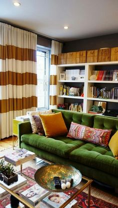 Updated classical apartment living with green velvet sofa, a sofa for life, seen at Apartment Therapy small cool contest