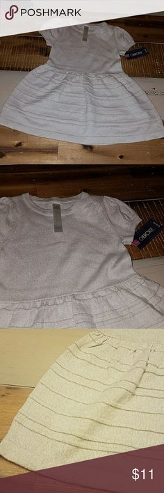 Cream and gold sweater dress Brand new with tags. Soft and stretchy cream colored sweater dress with metallic gold thread. Has floral detail on front. Super pretty. Cherokee Dresses