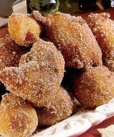 """""""Filhós"""" - rich donut-like batter, deep-fried and tossed in sugar. variety of flavours - pumpkin included. Portuguese Sweet Bread, Portuguese Desserts, Portuguese Recipes, Portuguese Food, Donut Recipes, Wine Recipes, Cooking Recipes, Easy Desserts, Dessert Recipes"""
