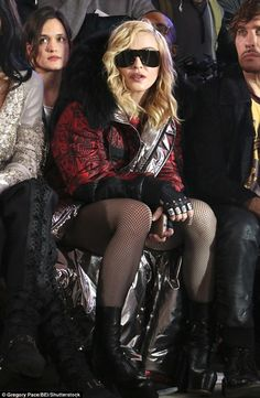 NY Fashion Week Feb 2017 PHILLIPP PLEIN show. Leggy lady! Madonna flashed her lean legs in a pair of fishnet stockings and donned heeled...