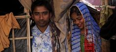 Rohingya refugees Saddam Hussein, and his wife Shofika Begum, pose in their temporary shelter at the Kutupalong refugee camp near Cox's Bazar, Bangladesh. May Allah bless their marriage and ease their situation. Current Events, Wedding Couples, Saddam Hussein, Marriage, Camping, Poses, World, Allah, Shelter