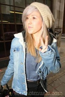 Fur lined denim jacket with a neutral beanie and grey crop top creating a casual, effortless look