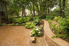 This lovely shade garden and patio area is part of a courtyard in Edmond, OK. This courtyard was constructed by Red Valley Landscape & Construction.