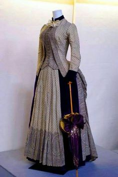 1885 fashion dress in purple paisley.