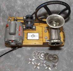 Meat Grinder by sausagemania -- Homemade meat grinder constructed from a hand grinder, 3/4hp motor, pulleys, speed brake, and a wood base. http://www.homemadetools.net/homemade-meat-grinder