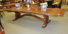 - Gorgeous extending Fleur Dy Lys French refectory table in oak<br /> - Top is pannelled and features a distinctive lyre end base<br /> - Solid and chunky this baby is built to last<br /> - Features two leaves each measuring 24 inches each<br /> - 13 feet when fully extended - large table<br /> - Hand crafted in France to centuries old traditions will last for many generations to come<br /> - Bought from a dealer in Avranches, ...