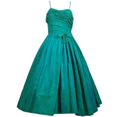Preowned Sensational 1950s Vintage Dress Iridescent Green Pleating Bow... ($595) ❤ liked on Polyvore featuring dresses, green, green slip, pleated dresses, vintage green dress, blue vintage dress and blue formal dresses