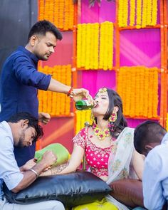 And comes the bride. Have you seen a more chiller bride than this one? 🍻🍺💃And comes the bride. Have you seen a more chiller bride than this one? Mehendi Photography, Indian Wedding Photography Poses, Bride Photography, Couple Photography Poses, Bridal Poses, Pre Wedding Photoshoot, Wedding Poses, Sister Poses, Sumo