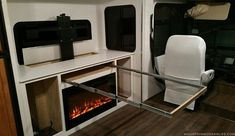 Our RV Renovation Photo Gallery   MountainModernLife.com Space Saving Table, Resource Furniture, Furniture Ideas, Expandable Table, Camper Makeover, Camping Car, Camping Life, Remodeled Campers, Electric Fireplace