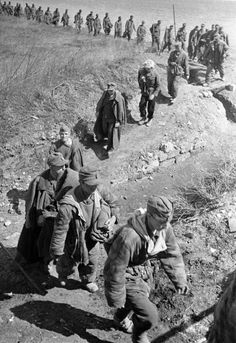 German prisoners of war being marched across a field, Odessa Oblast, Ukraine, Apr 1944  Photographer   Georgi Zelma  Source   Russian International News Agency