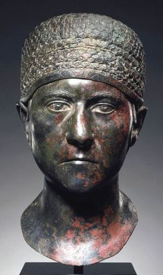 Roman, Trajanic Portrait head of a woman, 98–117CE. Bronze with silver inlay.