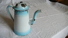 Bursting with mid century shabby chic, this is a lovely enamel pitcher.   I LOOOOVE these enamel pots, I want to keep them really! well its currently on display in my kitchen until you take it!  Most definitely shabby chic charm, the rust spots and chips, for me add to the pre-loved antique delight! A very typical item that would have been found in many french country homes in the 1940s-50s. shabby chic and rustic charm.. fantastic! great bright colour too... . This pot measures: 23cm tall…
