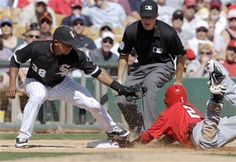 Los Angeles Angels' Erick Aybar (2) beats the tag from Chicago White Sox third baseman Eduardo Escobar (38) to steal third during the fifth inning of a spring training baseball game on Wednesday, March 14, 2012, in Glendale, Ariz