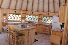 yurt homes | Comfortable leather couches and a big flat-screen TV for Captain ...