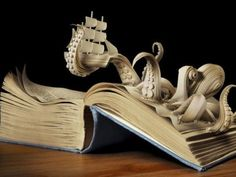Altered book- I love how cool this looks, but it hurts to tear up that book! I don't know how they do that!