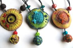 Polymer clay textured pendants- artist? from a Flickr fave album.