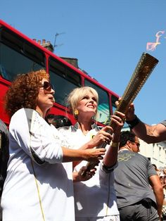 Torchbearers Joanna Lumley and Jennifer Saunders carry the Olympic Flame during Day 69 of the London 2012 Olympic Torch Relay.
