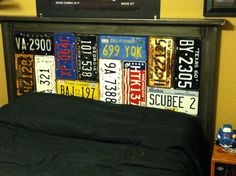 """License Plate Headboard   Welded 3""""x1"""" square pipe for the frame. Cleaned the metal and clear coated it. Welded tabs for 3/4"""" plywood backing. Used galvanized screws for the license plates.  Made by my husband for our teenage son."""
