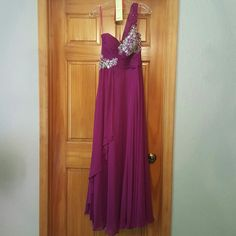 Gown Beautiful flowing, floor length one shoulder gown, with stunning bead work and magenta color. In size 6. Only worn for 5 hours. Dresses Wedding