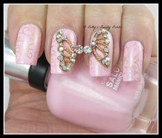 http://www.bettysbeautybombs.com/2014/11/02/born-pretty-store-butterfly-wing-rhinestone-nail-studs-review/ / Butterfly Rhinestone Nail Art using Sally Hansen Polish