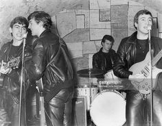 Rock and roll band 'The Beatles' performs onstage at the Cavern Club in February 1961 in Liverpool, England. (L-R) George Harrison, Paul McCartney, Pete Best, John Lennon. Credit: Michael Ochs Archives