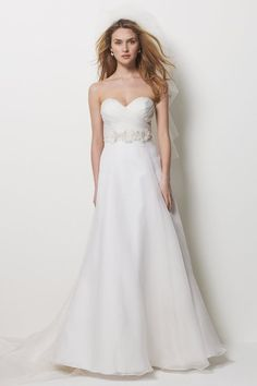 This Watters Carmel dress drapes perfectly.  I would add a black (floral) sash, to tie it in with the other elements.