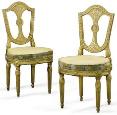 A pair of Italian carved giltwood chairs, Roman, late 18th century.
