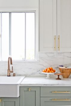 Shaker kitchen cabinets/brass hardware/farm sink/marble backsplash