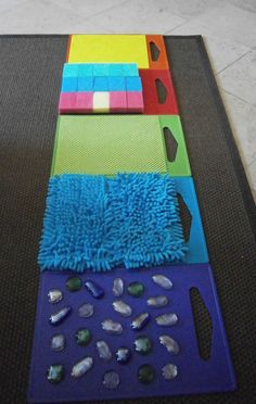 Awesome sensory activity for preschool or toddler kids. Make a sensory walkway!Tap the link to check out great fidgets and sensory toys. Check back often for sales and new items. Happy Hands make Happy People! Motor Activities, Infant Activities, Preschool Activities, Senses Activities, Creative Activities For Kids, Tactile Activities, Senses Preschool, Indoor Activities, Kids Fun