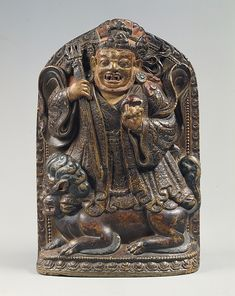 Dharmapala Standing on a Lion Date: ca. 16th century Culture: Tibet Medium: Stone with traces of gold paint, inlaid with turquoise Dimensions: H. 8 1/2 in. (21.6 cm); W. 5 3/4 in. (14.6 cm); D. 2 1/4 in. (5.7 cm); Wt. 6 lbs (2.7 kg) Classification: Sculpture