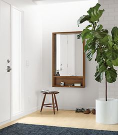 Give your space an instant update by adding modern mirrors. From leaning mirrors to mirrors on the wall, these versatile objects can make rooms appear larger, bring in light and provide artful personality. Here are four ways to use mirrors to reflect your style and transform your rooms.