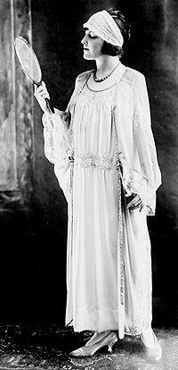 1920s lingerie included flowing lace trimmed chiffon negligees that were loose-fitting and cut similarly to the fashionable dresses of the day.