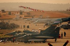 Tejas parked next to F-16 Fighting Falcon and Eurofighter Typhoon at 2009 Aero India