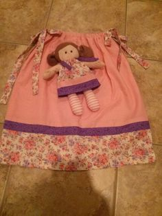 Operation Christmas Child pillowcase dress and doll - I like how the dolly's dress matches the little girl's.
