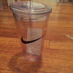 Nike reusable plastic cup with straw NWT clear Nike plastic cup with screw on kid and straw! Four left!! Feel free to bundle for discounts!! Nike Accessories
