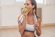 Active athletic sportive woman with towel in sport outfit eating apple after the , Sport Chic, Sport Girl, Organization Xiii, Bra Video, Nutrition, Sport Body, Healthy People 2020 Goals, Health Eating, Workout Videos