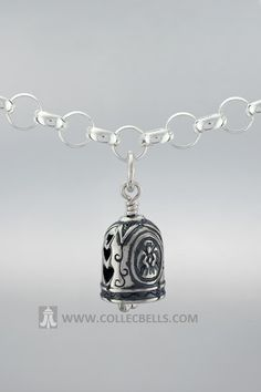 """Decorated with angels and hearts this silver charm is a gift inspired by God's perfect love.   Includes a card that begins: """"We are all Gods' angels, His hands on Earth. He guides and inspires us..."""""""