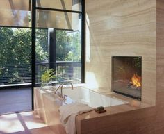 Nice integration of bathtub and #fireplace in this bathroom by Studio William Hefner.
