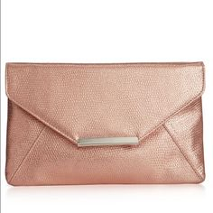 "Rose gold sleek envelope clutch Sophisticated and ever chick! Carry all your essentials in this party perfect envelope clutch! Slim and sleek profile! Perfect rose gold color! Magnetic snap closure! Exterior features gold tone hardware! Interior features 1 slip pocket. 10-1/2""W x6-1/2"" H X 1/4""D brand new with tags never used Bags Clutches & Wristlets"