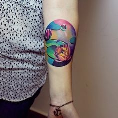 Get an artistic water lily. | 32 Cool And Colorful Tattoos That Will Inspire You To Get Inked