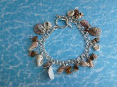 Ocean Bracelet  shell tiger eye calcite by BazaarCharlotte on Etsy, $25.00