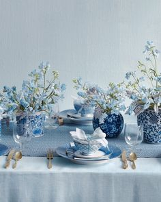 Instead of something blue, enlist all things blue, including periwinkle blooms transforming your tabletops and celestial swirls fancying up your footwear.Here, we mix-and-matched patterns and airy clusters of delphiniums, muscari, and dusty miller make this tablescape richly multilayered, not dully monochromatic. To greet guests, top each dinner plate with a gift. Pastel geometric bowl-and-spoon sets act as favors.Pearl River rice bowls, spoon, and vases.