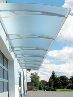 Lightline® Extendable Canopies: ​Extendable Canopies with blue tint panels on commercial application Awning Canopy, Backyard Canopy, Patio Canopy, Canopy Outdoor, Gate Design, Roof Design, Exterior Design, House Design, Front Door Canopy