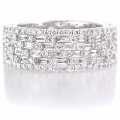 This beautiful 18k white gold six row eternity wedding band ring features 68 baguette cut and 170 round brilliant cut white diamonds of F color, VS2 clarity and excellent cut and brilliance, weighing 3.50 carats total.
