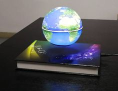 how to make the magic magnetic floating globe float, Funny C Shape Magnetic Levitation Floating Globe World Map with Colored LED Light Floating Globe, Magnetic Levitation, Levitation Photography, Futuristic, Snow Globes, Robot, Room Ideas, Toys, Notebook