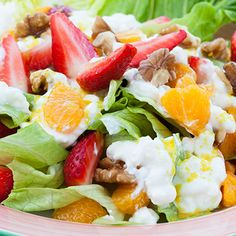 Recipe of the Day: Strawberry Sundae Salad. This light-but-filling salad combines juicy strawberries with protein-rich cottage cheese, leafy greens, and granola, all dressed up with a sweet, citrusy orange dressing (and we added walnuts and chunks of orange for added nutrition and taste). #salad #recipe #healthy #lunch #10saladchallenge #strawberry