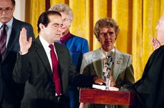 Archival footage shows Antonin Scalia being sworn in as a Supreme Court justice by Chief Justice Warren E. Burger in September 1986.