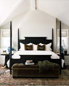 like the neutral colors here; love the bench at end of bed; oriental rug; symmetry; black bed