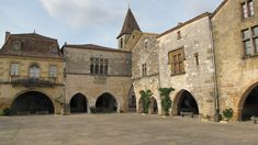 Medieval Town Square, Monpazier (Bastide Town)   by Tracey & Doug